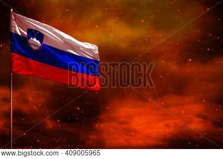 Fluttering Slovenia Flag Mockup With Blank Space For Your Data On Crimson Red Sky With Smoke Pillars