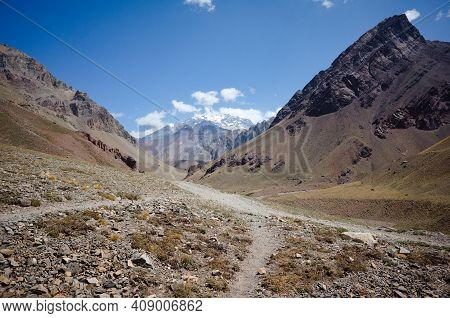 Andes Mountains Landscape With Hiking Trail With No People. Arid Climate Desert And Rocky Mountains.