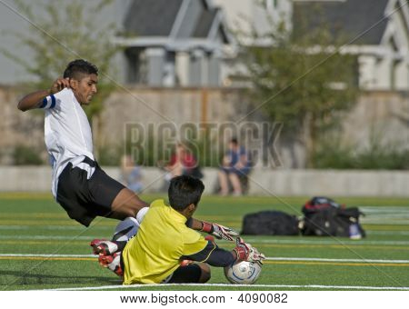Boys Hs Varsity Soccer Keeper Diving For The Ball