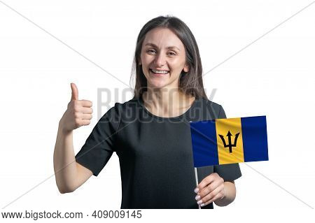 Happy Young White Woman Holding Flag Of Barbados And Shows The Class By Hand Isolated On A White Bac