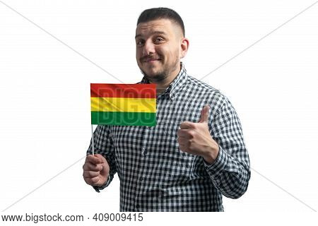 White Guy Holding A Flag Of Bolivia And Shows The Class By Hand Isolated On A White Background. Like