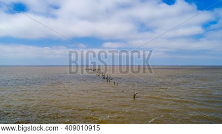 Remnants Of A Pier On Mobile Bay From Daphne, Alabama In February Of 2021