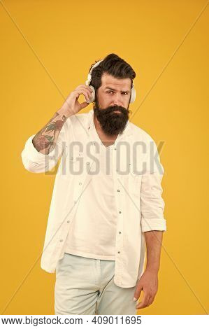 Audio Enjoyment. Instrumental Music. Bearded Man Headphones Yellow Background. Perfect Sound. Hipste