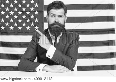 Language School Promoting. Teacher Point Finger At American Flag Background. Promoting And Motivatin