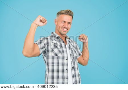 Awesome. Happy Man With Winner Gesture. Mature Guy On Blue Background. Sportsman With Bristle On Hap