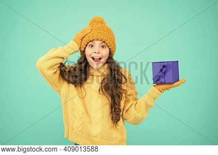 Enjoy Receiving Presents. Christmas Gifts For Kids. Kid Little Cheerful Girl Hat Long Hair Hold Gift