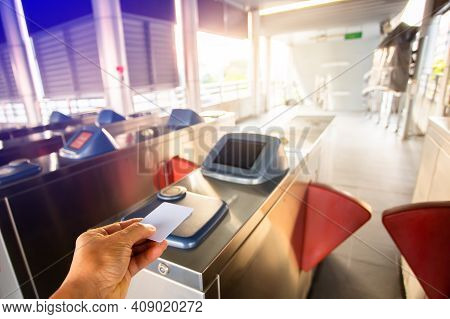 Selective Focus To Hand Of Passenger Using Smart Card To Open Automatic Gate Machine At Sky Train St