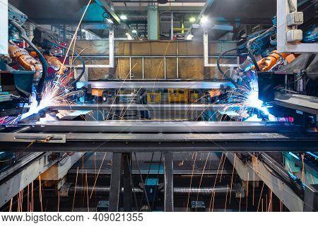 Welding Robot, Welds Metal Beams. Modern Welding Production