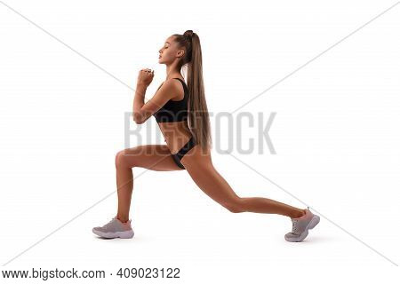 Smiling Fit Woman In Underwear Doing Sport Exercise In Studio