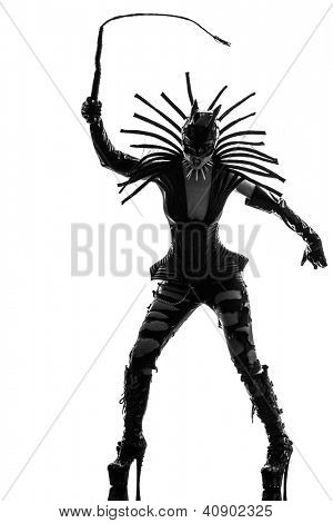 one caucasian woman in catwoman leather latex whith whip  in silhouette studio isolated on white background