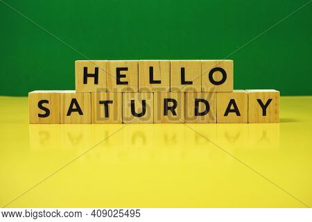 Hello Saturday Alphabet Letter With Space Copy On Green And Yellow Background