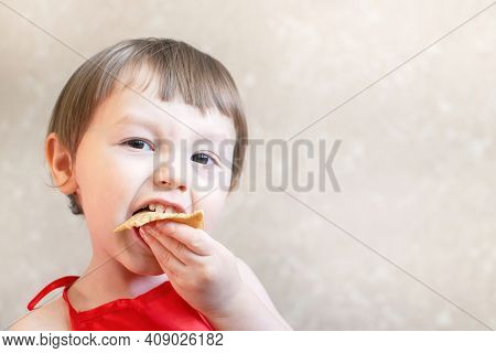 Little Funny Boy Eating Pancakes With His Hands. Delicious Pancakes.