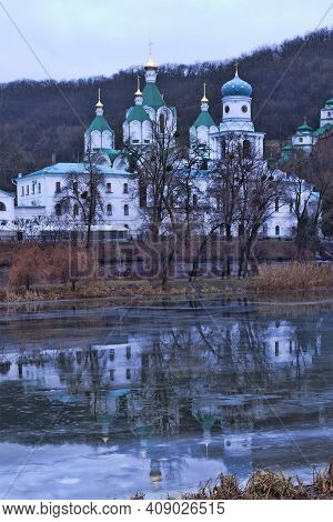 Church Svyatohirsk Lavra Over The River Siversky Donets In Winter. There Is An Ice On The River, You