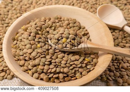 Natural Organic Dry Brown Lentils For A Healthy Diet. Background Selective Focus