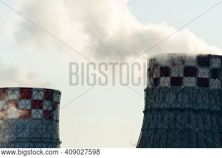 Smoke From Industrial Pipes Close Up. Industrial Zone. Environmental Pollution Selective Focus