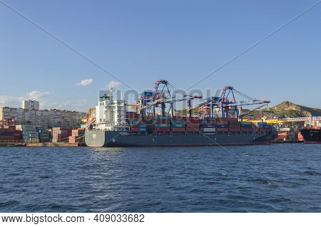 Vladivostok, Russia - October 07, 2020: Freighter Filled With Goods On Sunny Day View From The Sea