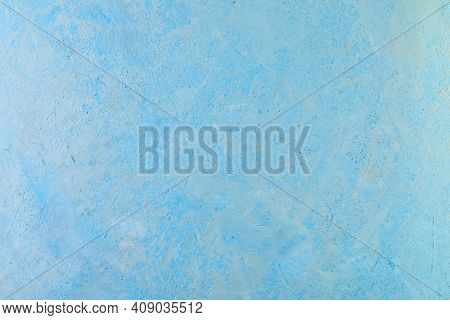 Background Texture Of Rough Plaster With White Splashes Of Blue