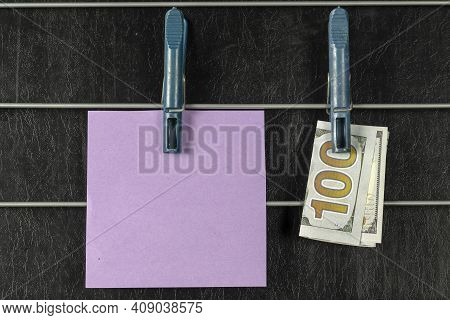 Paper Sticker And A One Hundred Dollar Bill Hanging From Clothespins. Lilac Blank Square Sticker And