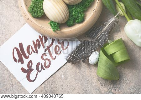 Easter Composition With Wooden Easter Eggs And Spring Flowers  Tulips On Concrete Background. Easter