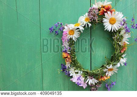 Flower Door Wreath. Midsummer Flower Crown On Rustic Wooden Background With Copy Space. Diy Floral W