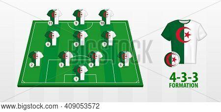 Algeria National Football Team Formation On Football Field. Half Green Field With Soccer Jerseys Of