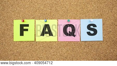 Color Notes With Letters Pinned On A Board. Word Faqs. Work Space.