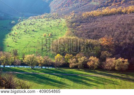 Impressive Aerial View Of Nature . Riverside Panorama With Meadows And Forest