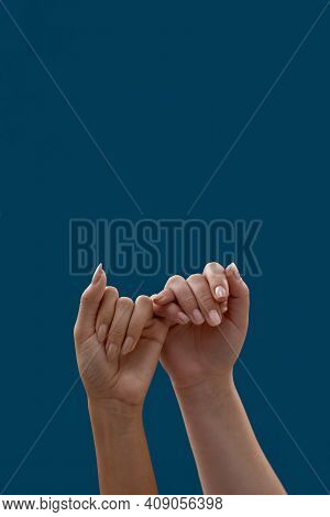 Close Up Of Two Hands Hooking Each Other Little Finger Pinkie As A Symbol Of Promise Or Pardon Isola
