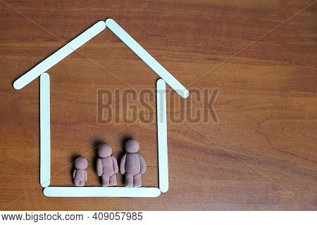 Figurines Of Man, Woman And Child At Home, Family Concept.