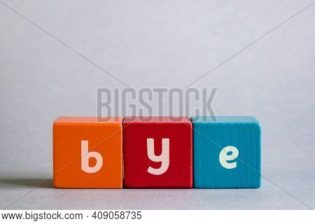 Bye - Word Made Of Colored Children's Wooden Cubes. Close-up. Copy Space. Selective Focus.
