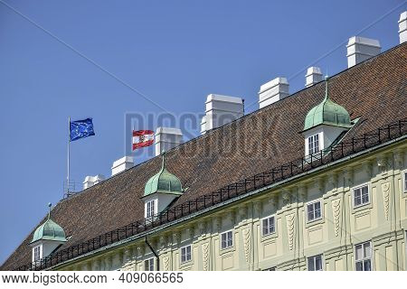 Vienna, Austria, May 2019: Flags Of The European Union And Austria On The Roof Of The Medieval Build