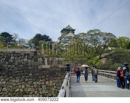 Osaka, Japan - April 4, 2018: The Bridge To Osakajo Castle In Osaka, Japan. Tourists Walk Across The