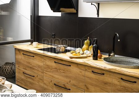 Oak Kitchen Worktop On Kitchen With A Sink, Cookstove And Food Ingredients, Bottle And Kitchen Facil