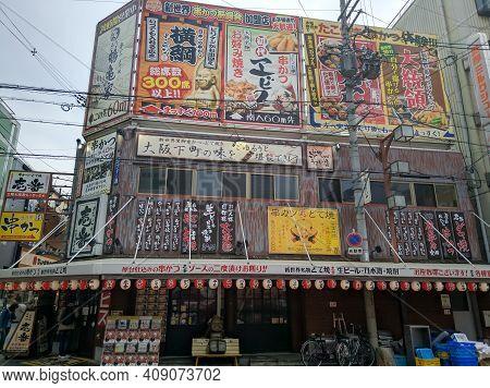 Osaka, Japan - April 4, 2018: Traditional Japanese Style Restaurant In Osaka, Japan. Bright Signs At