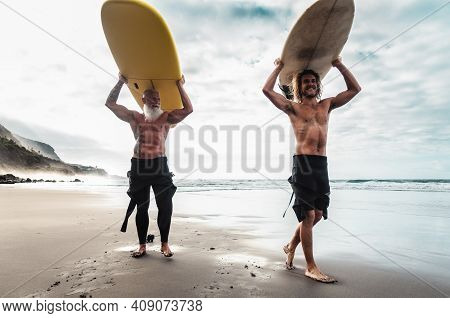 Happy Friends Surfing Together On Tropical Ocean - Sporty People Having Fun During Vacation Surf Day
