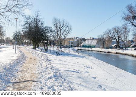Snowy View On Pathway On Radunia River In Pruszcz Gdanski, Poland.