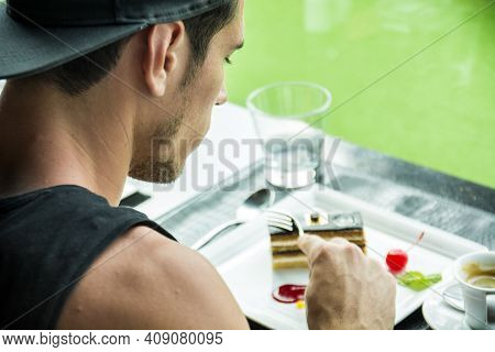 Attractive Young Mans Breakfast, Eating Cake At Diner