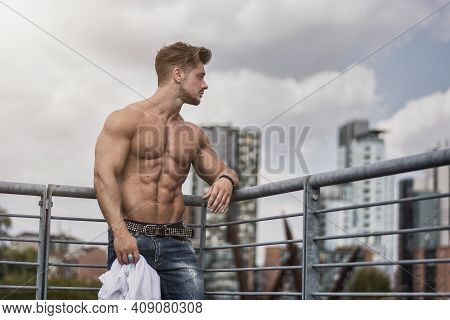 Handsome Muscular Shirtless Hunk Man Outdoor In City