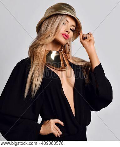 Portrait Of Stylish Arrogant Rich Blonde Woman In Black Blouse With Deep Neckline, Golden Necklace C