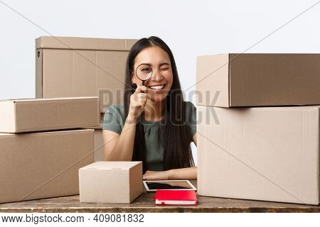 Small Business Owners, Startup And E-commerce Concept. Smiling Asian Businesswoman Processing Client