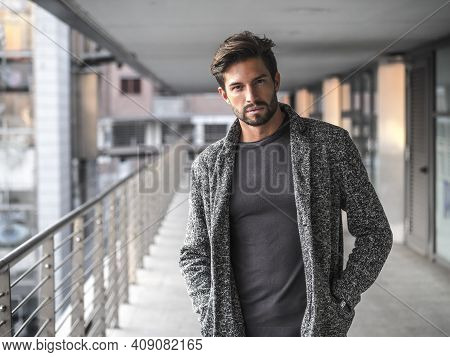 One Attractive Man In City Environment Wearing Cardigan