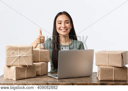 Small Business Owners, Startup And E-commerce Concept. Happy Asian Businesswoman With Online Shop, P