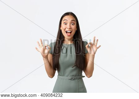 Small Business Owners, Women Entrepreneurs Concept. Excited Happy Asian Woman Looking Pleased And Ex