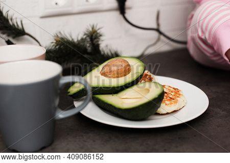Half An Avocado For Breakfast. Homemade Breakfast With Avocado.