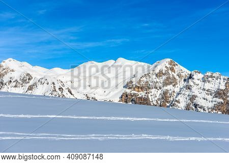 The Mountain Range Of The Monte Carega In Winter With Snow, Also Called The Small Dolomites View Fro