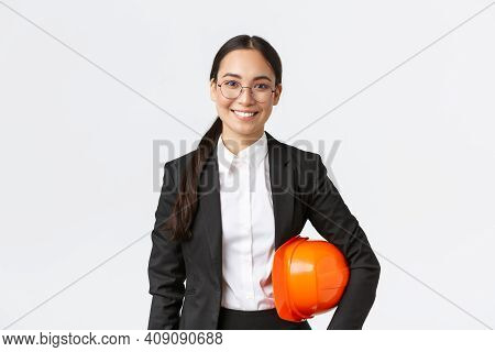 Portrait Of Happy Professiona Female Asian Construction Manager, Engineer In Business Suit Holding H