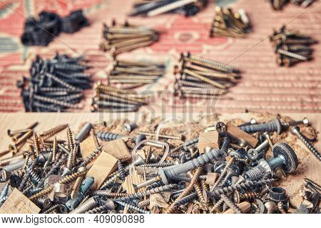 Woodwork Garbage And Sorted Self-tapping Screws On Table
