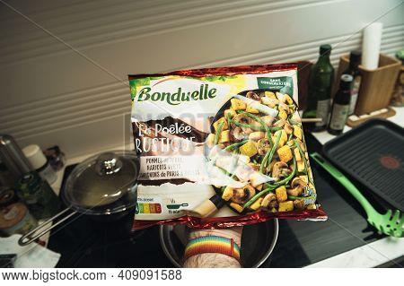 Paris, France - Feb 13, 2021: Pov Male Hand Holding Package With Delicious Bonduelle La Poele Rustiq