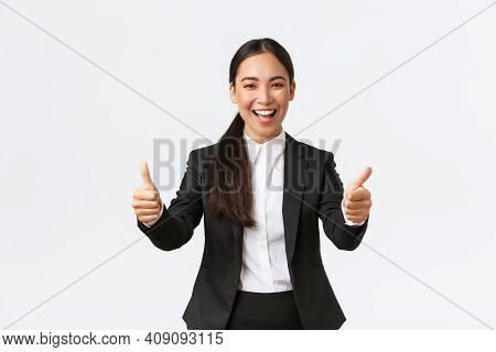 Successful Upbeat Asian Businesswoman Showing Thumbs-up And Smiling Happy. Cheerful Lady Manager In