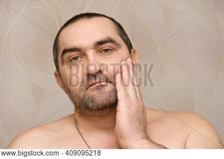 40-year-old Bearded Man Touches Stubble On Face With Hand. Time To Shave Your Beard. Male Facial Car